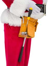 Santa works to install Christmas decorations