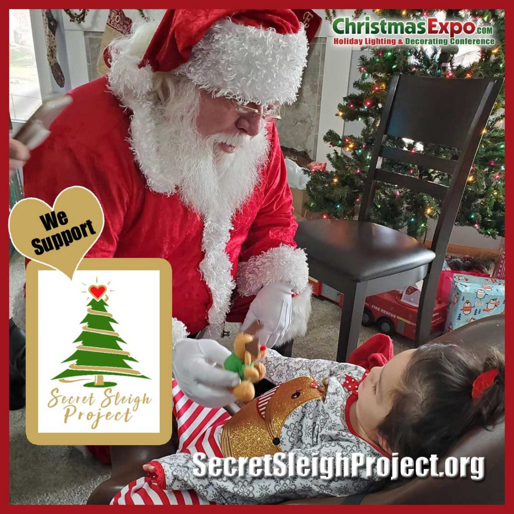Santa visits with a child